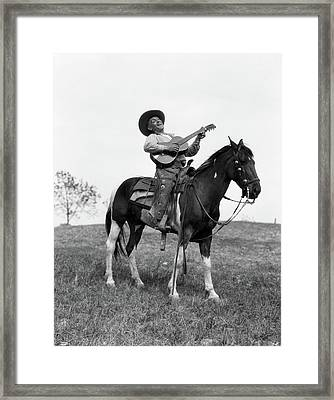 1920s Cowboy On Horse Singing & Playing Framed Print