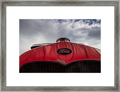 1920s Ford Emblem Against Sky Framed Print
