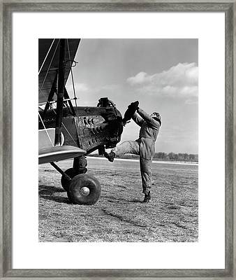 1920s Male Pilot Trying To Turn Planes Framed Print