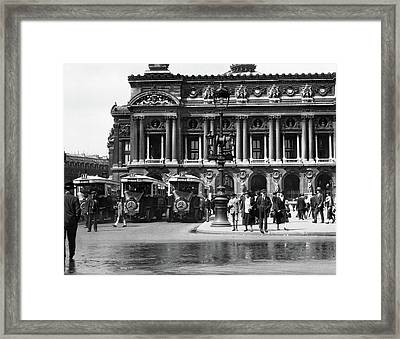 1920s Pedestrians And Busses At Place Framed Print