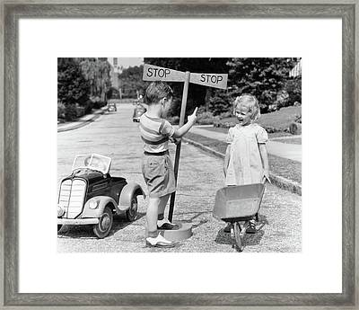 1930s 1940s Boy Playing Traffic Cop Framed Print