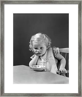 1930s 1940s Sad Baby Girl At Table Framed Print