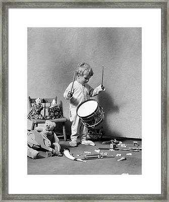 1930s Boy In Pajamas Beating On Toy Framed Print