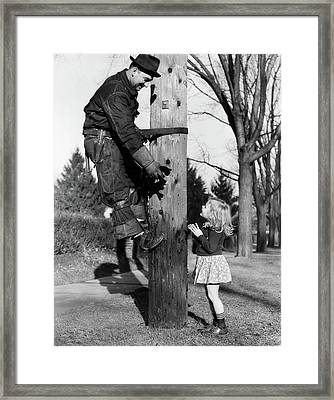 1930s Electric Linesman Rescuing Kitten Framed Print