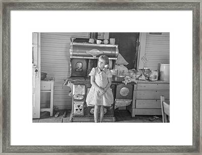 1930's Girl Standing By Stove Framed Print