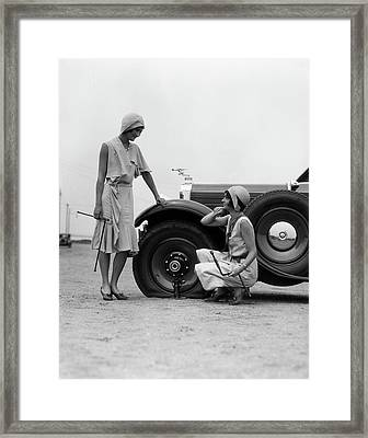 1930s Two Women Confront An Automobile Framed Print