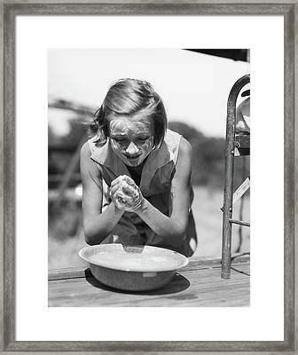 1930s Young Girl Leaning Over Bowl Framed Print