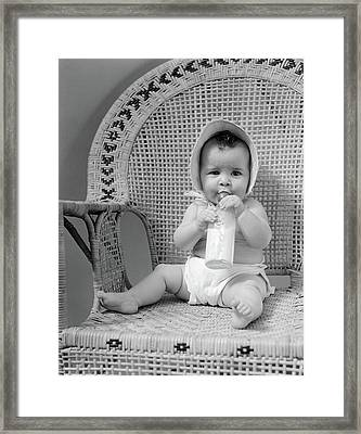 1940s Baby Sitting In Wicker Chair Framed Print