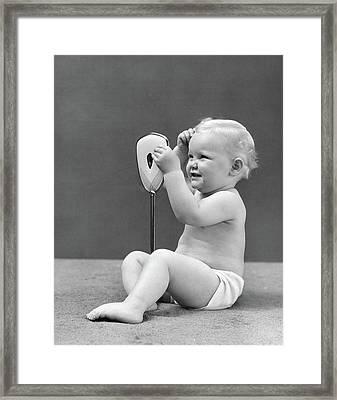 1940s Blond Baby Girl Holding Vanity Framed Print