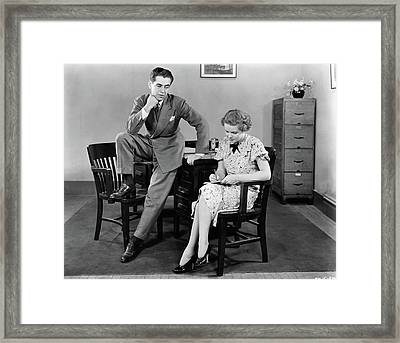 1940s Businessman Leaning Against Desk Framed Print