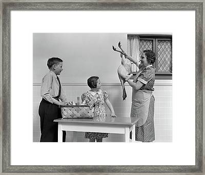 1940s Housewife In Kitchen Showing Raw Framed Print