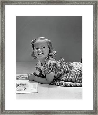 1940s Little Blond Girl Lying On Floor Framed Print