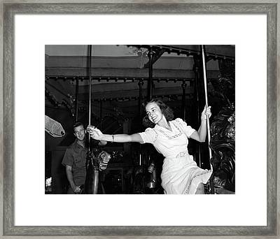 1940s Smiling Woman On Carousel Framed Print