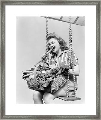 1940s Woman Sitting On A Rope Swing Framed Print