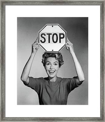 1950s 1960s Smiling Woman Holding Stop Framed Print