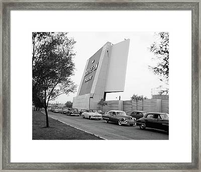 1950s Automobiles In Line To Enter Framed Print