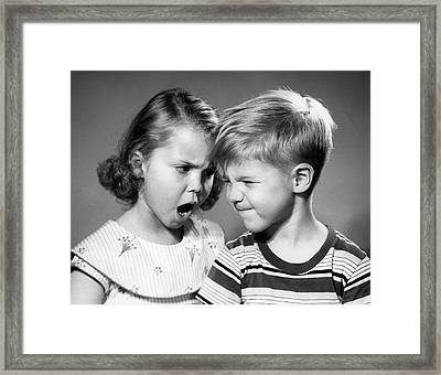 1950s Boy And Girl Arguing Head To Head Framed Print