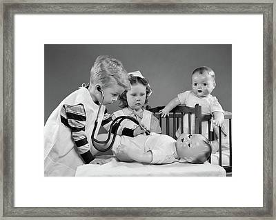 1950s Boy And Girl Playing Doctor Framed Print