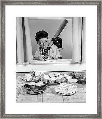 1950s Boy In Baseball Garb With Bat Framed Print