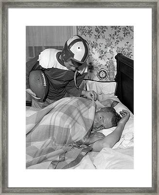 1950s Boy In Football Uniform Waking Framed Print