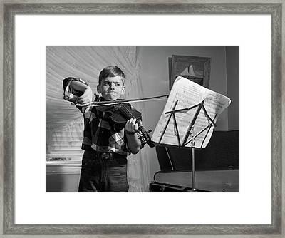 1950s Boy In Living Room Practicing Framed Print