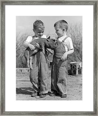 1950s Boys In Striped Overalls Holding Framed Print
