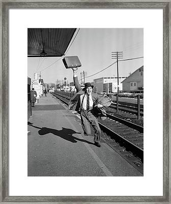 1950s Businessman With Briefcase In Air Framed Print