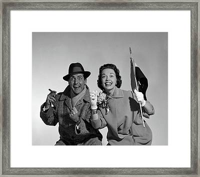 1950s Couple Portrait In Coats Rooting Framed Print