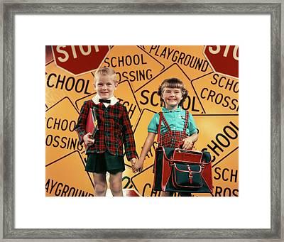1950s Girl And Boy With Bookbag Framed Print