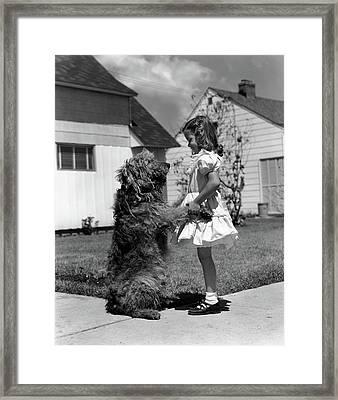1950s Girl On Suburban Sidewalk Holding Framed Print