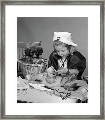 1950s Girl Wearing Nurses Uniform Framed Print