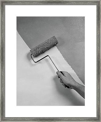 1950s Hand Using Paint Roller On Wall Framed Print