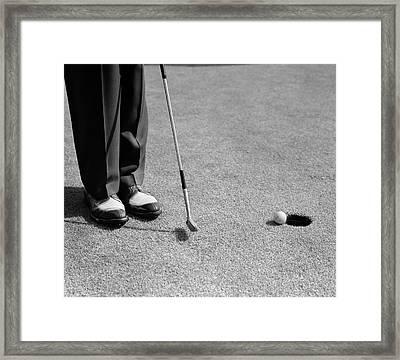1950s Man Knees Down Putt On Golf Green Framed Print