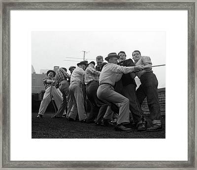 1950s Men Playing Tug-of-war Framed Print