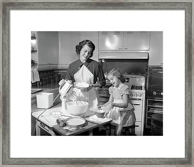 1950s Mother & Daughter Baking A Cake Framed Print