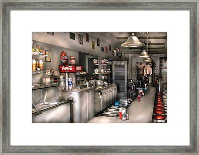1950's - The Soda Fountain Framed Print by Mike Savad
