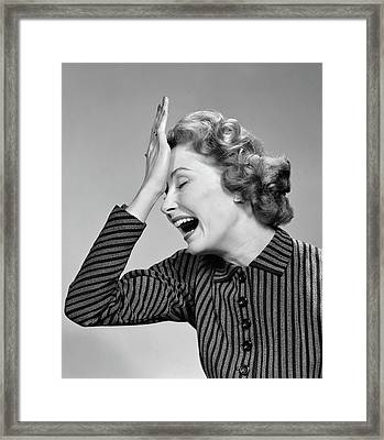 1950s Woman Hitting Forehead With Heel Framed Print