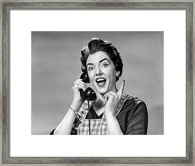 1950s Woman In Apron Talking Framed Print