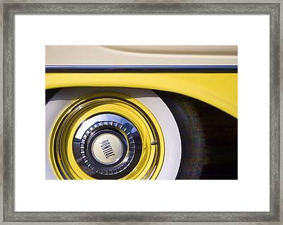 1957 Pontiac Starchief Wheel Cover Framed Print by Carol Leigh