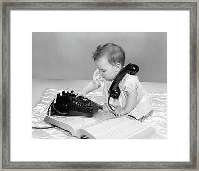 1960s Baby Girl With Telephone Book Framed Print