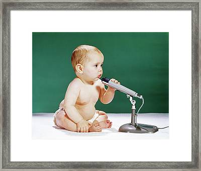 1960s Baby Holding And Talking Framed Print