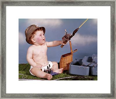 1960s Baby In Fisherman Hat Holding Framed Print
