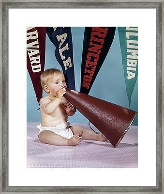1960s Baby Shouting Into Cheerleader Framed Print