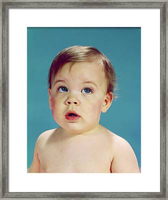 1960s Baby With Uncertain Facial Framed Print