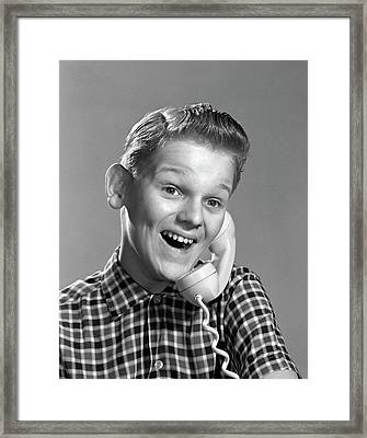 1960s Boy On Telephone With Excited Framed Print