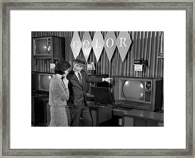 1960s Couple Shopping For Color Tvs Framed Print