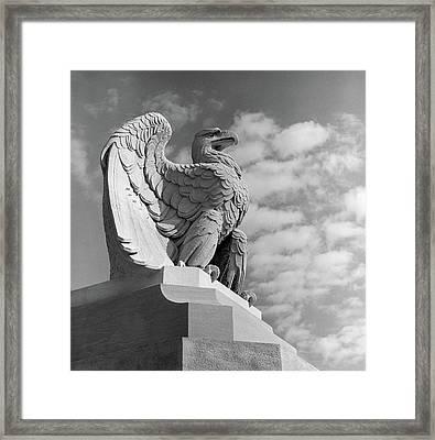 1960s Eagle Statue Against Sky Clouds Framed Print