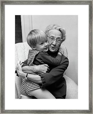 1960s Grandmother In Chair Hugging Framed Print