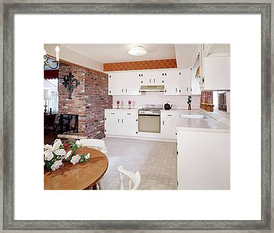 1960s Kitchen Interior With Brick Wall Framed Print