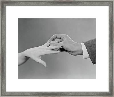 1960s Male Hand Slipping Engagement Framed Print